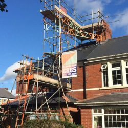 Place Chimney stack scaffolding to keep off the slates